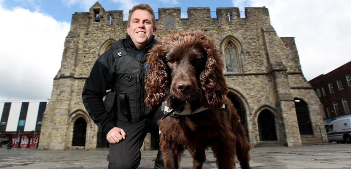 Dog handler Stuart Phillips with specialist tobacco sniffer dog Yoyo.