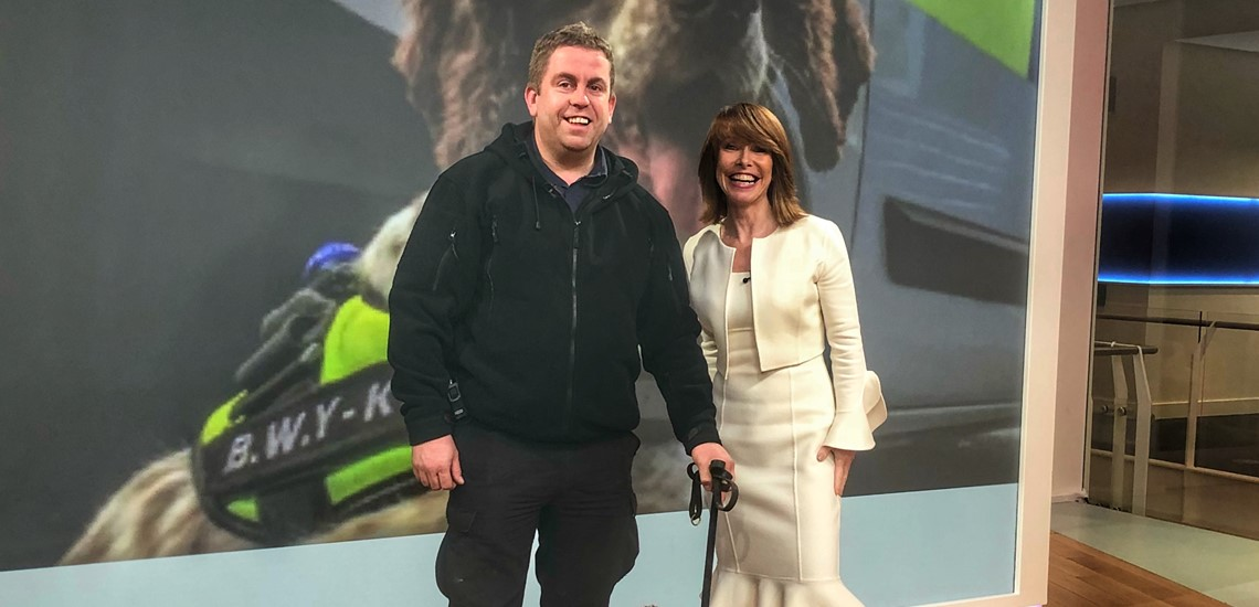 Scamp pictured with SKY presenter Kay Burley and handler Stu Phillips